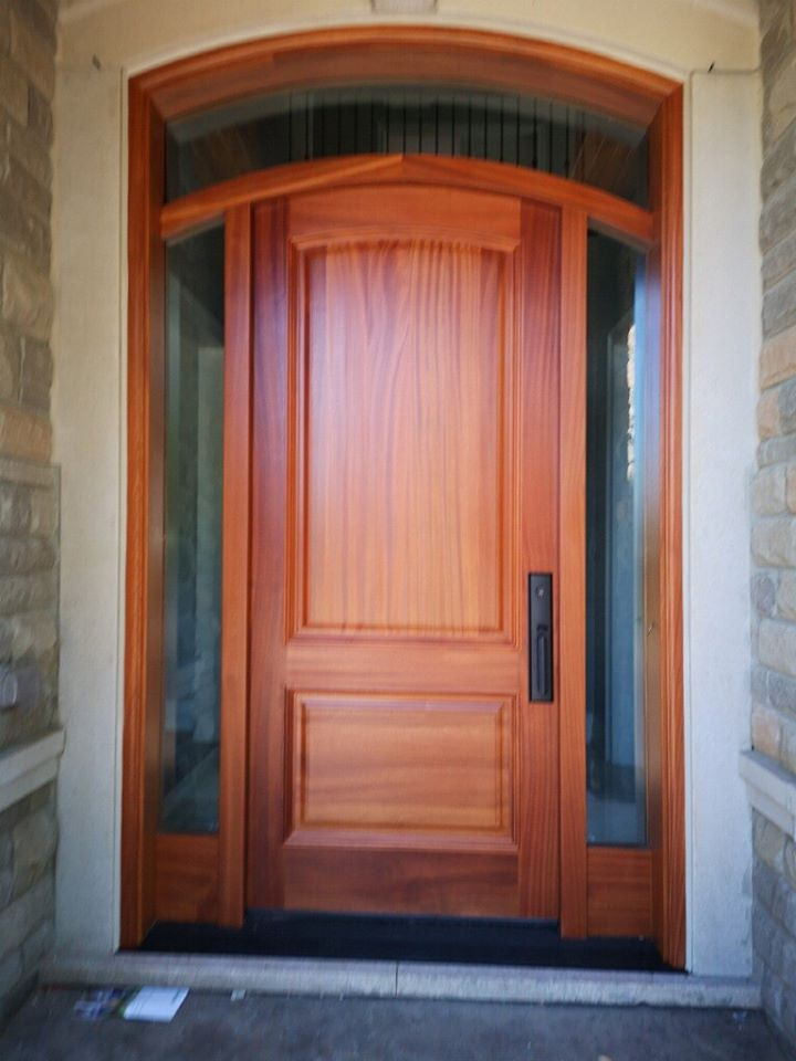 """""""No varnish can hide the grain of the wood, and that more varnish you put on, the more the grain will express itself."""" #SolidWood, #Doors, #Wood, #Mahogany, #CustomMadeDoors, #DoorSupplier, #ExteriorDoors, #InteriorDoors #DoorManufacturer, #EntryDoors. #Woodwork, #MadeinCanada, #DistinctiveLook, #FityourHome Made by #NorthwoodDoorsInc. Your best value and quality, #HandCraftedDoors. Every door manufactured by us has our corporate stamp - a testament to our dedication and passion in woodwork. Let #NorthwoodDoorsInc. add to your home's #CurbAppeal by enhancing the quality and beauty of your #EntryDoors. Visit our #Showroom to envision how one of our many #doors on display might look like at your #Home. Contact us today Tel. 416-253-2034, info@northwooddoors.com, www.northwooddoor.com — in Toronto, Ontario"""