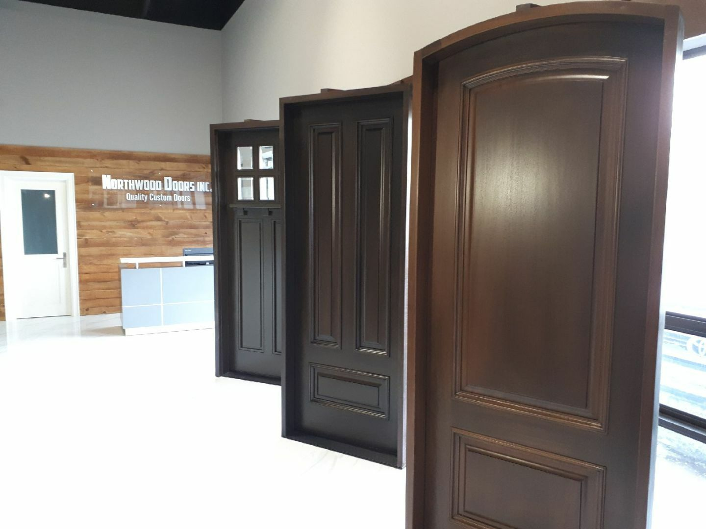Visit our showroom to envision how one of our many doors on display might look like at your home. www.northwooddoors.com